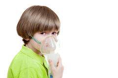 The boy with inhaler Royalty Free Stock Photo