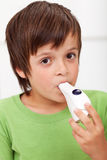 Boy with inhaler - closeup Stock Images