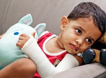 Boy injured. Cute boy with his hand in plaster cast Royalty Free Stock Images