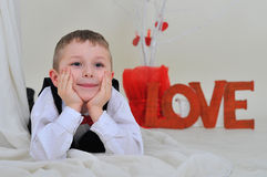 Boy with the inscription love. Royalty Free Stock Photography