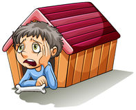 A boy inside the doghouse Royalty Free Stock Photos
