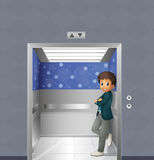 A boy inside the elevator Royalty Free Stock Photos