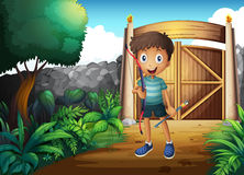 A boy inside the gated yard with a bow and arrow Royalty Free Stock Photos
