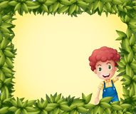 A boy inside a leafy frame Royalty Free Stock Photos