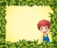 A boy inside a leafy frame Royalty Free Stock Photos