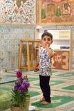 Boy inside of Mausoleum of Harun Vilayat, Imamzadeh Haroun-e-Velayat in Imam Ali Square in Isfahan. Iran. Isfahan, Iran - March 21, 2018: Iranian boy inside of royalty free stock image