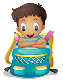 A boy inside a schoolbag Royalty Free Stock Image