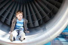 Boy inside turbine Stock Images