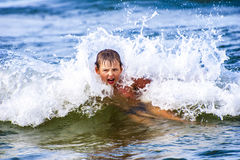 Boy Inside Wave royalty free stock photography