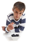 Boy inspecting blueberry Stock Photo