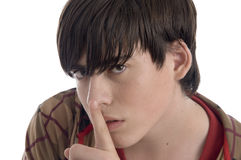 Boy instructing you to keep silent. On an isolated background Royalty Free Stock Images