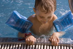 Boy inswimming-pool Royalty Free Stock Photo