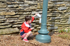 Boy investigates outlet Royalty Free Stock Images