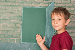 Boy inviting with gesture to magic. Education concept with little boy inviting with gesture to magic school Stock Image