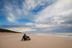 A boy on the isolated australian beach Royalty Free Stock Photo