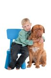 The boy and its dog. Little boy hugging its dog Stock Image