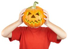 Boy with jack-o-lantern. halloween. Royalty Free Stock Images