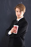 Boy in the jacket with a cup of coffee Royalty Free Stock Image