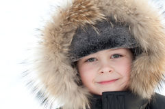 Boy in a jacket with fur Stock Images