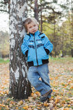 Boy in  jacket and jeans Stock Photos