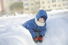 Boy In Jacket Leaning On Snow Heap Royalty Free Stock Image