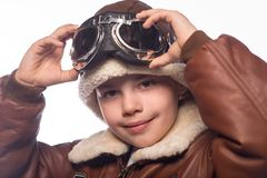 The boy is an aviator in the jacket of the pilot and in old glasses Stock Image