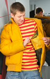 Boy in jacket stay in fitting-room Stock Photography