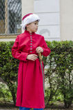 Boy janissary. Side profile of boy dressed as Ottoman janissary with red tunic and turban on May 10, 2014 in Bucharest Royalty Free Stock Photo