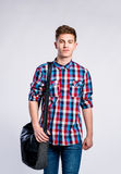Boy in jeans and shirt, young man, studio shot Stock Photo