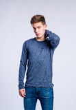 Boy in jeans and sweater, young man, studio shot Royalty Free Stock Photo
