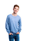 Boy in jeans and sweater, young man, studio shot. Teenage boy in jeans and blue sweatshirt, young man, studio shot on white background, isolated Stock Image