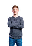 Boy in jeans and sweater, young man, studio shot Royalty Free Stock Photography