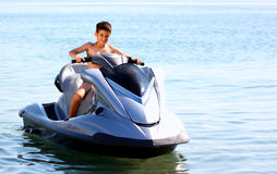 A boy on a jet ski. Ready to start driving royalty free stock image