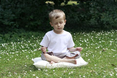 Boy and joga Royalty Free Stock Photo