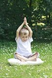 Boy and joga Royalty Free Stock Photos