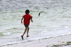 Boy Jogging. A young boy jogging along the beach Royalty Free Stock Photo