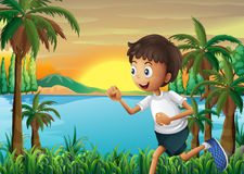 A boy jogging near the river Stock Photos
