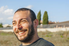 Boy with a joyful smile - italian man. Portrait in a stolen shot with joyous smile Royalty Free Stock Photography