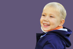 The boy is joyful and smiling royalty free stock image
