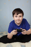 Boy with a joystick Royalty Free Stock Images