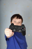 Boy with a joystick Stock Photography