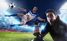 Boy with joystick plays with soccer video game royalty free stock images