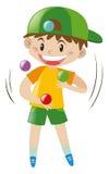 Boy juggling four balls Royalty Free Stock Photos