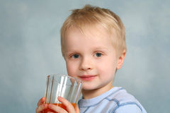 Boy and juice Stock Photography