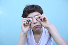 Boy with jujube marshmellow eyes smiling open mouth close up portrait royalty free stock photo