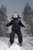 Boy jump in winter outdoors Royalty Free Stock Photos