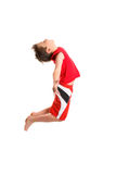 Boy jumpging arms outstretched Stock Images