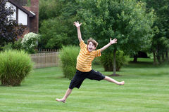 Boy Jumping. Off of trampoline Stock Images