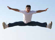 Boy jumping. Boy making a split high in the air Royalty Free Stock Photo