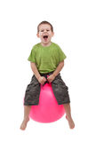 Boy jumping. On a large ball Royalty Free Stock Photography